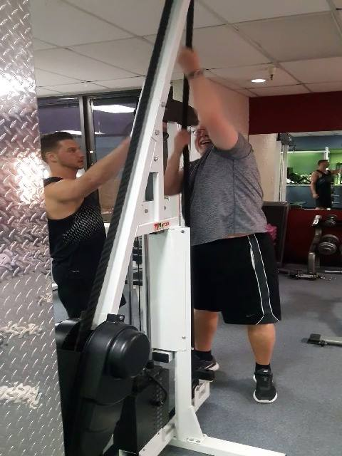 Joe coaching Dave on our rope machine.